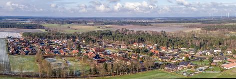 Aerial landscape photo, panoramic view of a small village between fields and meadows, as banner for a blog or website Stock Image