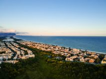Aerial landscape photo of Recreio dos Bandeirantes beach during sunset, with views of Chico Mendes park.  Stock Photography