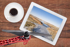 Aerial landscape photography concept. Reviewing aerial pictures of  the Horsetooth Reservoir in Colorado on a digital tablet with a drone rotor in foreground Royalty Free Stock Images