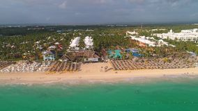 Aerial landscape view of Caribbean tropical beach. Travel and vacation in Bavaro resort. Punta Cana, Dominican Republic. Aerial landscape view of Caribbean stock video
