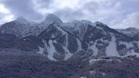 Aerial landscape view of Caucasus Mountains in Gorky Gorod ski and snowboard resort, Sochi, Russia. Aerial landscape view of Caucasus Mountains in Gorky Gorod stock footage