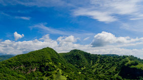 Aerial landscape view of green mountains and blue sky. With clouds at village Candidasa, Bali, Indonesia Stock Photography