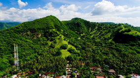 Aerial landscape view of green mountains and blue sky. With clouds at village Candidasa, Bali, Indonesia Stock Image