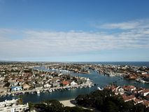 Aerial landscape view of Huntington Harbor in Huntington Beach, Orange County, Southern California. With boats, homes and Pacific Ocean Stock Images