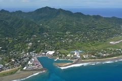 Aerial landscape view of Rarotonga Cook Islands. Aerial landscape view of Port of Avatiu , Avarua Town and Avarua District  in Rarotonga Island in the Cook Stock Images