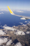 Aerial landscape. Wing of a commercial airplane upon takeoff from Valencia. Spain Stock Images