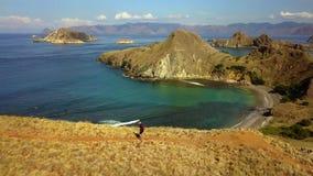 Aerial landscape of woman walks on Padar Island stock footage
