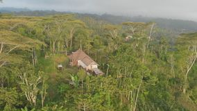 Aerial landscapes of Indonesian fields, hills and villages on the island of Bali. Aerial landscapes of Indonesian fields, hills and villages on the island of stock video