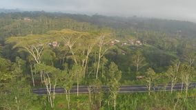 Aerial landscapes of Indonesian fields, hills and villages on the island of Bali. Aerial landscapes of Indonesian fields, hills and villages on the island of stock video footage