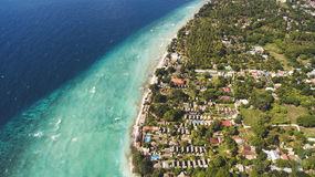Aerial landscapes. Aerial photo from drone of perfect sand and crystal clear water in a thousand shades of blue all this in Paradise island of Indonesian Stock Photo