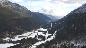 Aerial – Late winter shot of a valley with some snow stock video