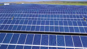 Aerial lateral motion view on solar power plant, beautiful countryside landscape, clean energy panels.  stock video footage