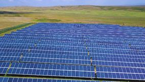 Aerial lateral motion view on solar power plant, beautiful countryside landscape, clean energy panels.  stock footage