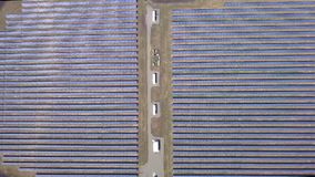 Aerial lateral motion view on solar power plant, beautiful countryside landscape, clean energy panels.  stock video