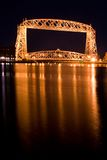 The Aerial Lift Bridge  (night). The Aerial Lift Bridge is a major landmark in the port city of Duluth, Minnesota. The span is a vertical lift bridge, which is Stock Images