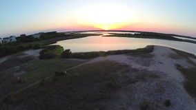Aerial lift to beautiful sunset over sound. Video of aerial lift to beautiful sunset over sound stock video