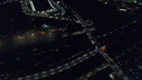 Aerial of Lights and Traffic in Oakland at Night. An aerial view of the busy highways in Oakland, CA. The city is known for its sustainability practices and stock footage