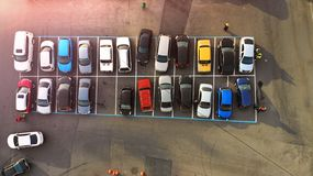 Aerial. Little city parking lot with colorful cars. royalty free stock photography