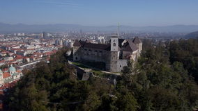 AERIAL: Ljubljana Castle with cityscape in the background stock video footage