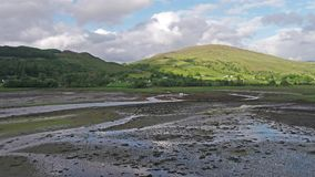 Aerial of Loch Laich and the historic castle Stalker in background stock footage