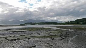 Aerial of Loch Laich and the historic castle Stalker in background stock video footage