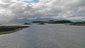 Aerial of Loch Laich and the historic castle Stalker in background stock video