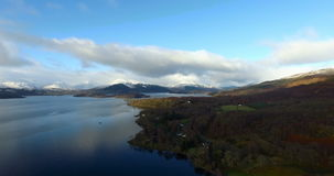Aerial: Loch Tay in the Scottish Highlands during a clear winters day with snow on Ben Lawers, Scotland.  stock video
