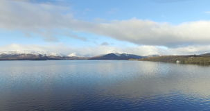 Aerial: Loch Tay in the Scottish Highlands during a clear winters day with snow on Ben Lawers, Scotland.  stock footage