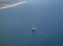 Aerial of Long Beach off shore drilling rig Stock Photography