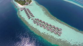 AERIAL: Luxurious over-water villas on tropical island resort, Maldives. Luxurious over-water villas on tropical island resort, Maldives stock video