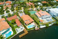 Aerial luxury homes on the water with pool Royalty Free Stock Image