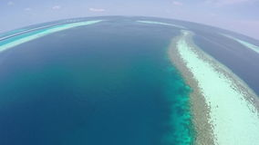 AERIAL: Luxury island resort on exotic white sand beach, Maldives. stock video