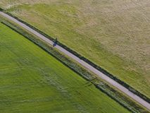 Aerial of meadowland separated by straight bicycle lane on the dutch island of Texel. Aerial made by drone of meadowland separated by straight bicycle lane on royalty free stock photos