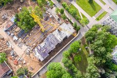 Aerial mage of construction site with yellow crane royalty free stock photography