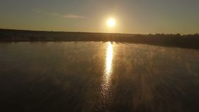 Aerial - magic sunset over lake. Aerial - magic sunset over lake stock footage