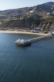 Aerial of Malibu Pier Near Los Angeles in Southern California. Aerial of historic Malibu pier near Los Angeles in Southern California Royalty Free Stock Photos