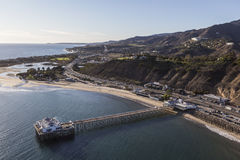 Aerial of Malibu Pier and the Santa Monica Mountains. Aerial of historic Malibu Pier, Pacific ocean beaches and the Santa Monica Mountains in Southern California Stock Images