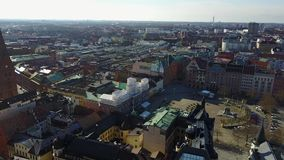 Aerial View of Malmo, Sweden. Aerial Malmo city view from above with harbour, turning Torso and the bridge on the horizon stock footage