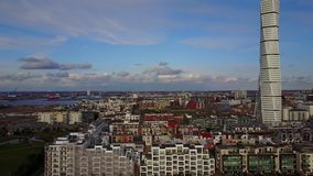 Aerial View of Malmo, Sweden. Aerial Malmo view of the Turning Torso skyscraper by the sea stock footage