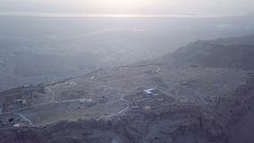 Aerial Masada and dead sea view in the morning. With low sun stock video footage