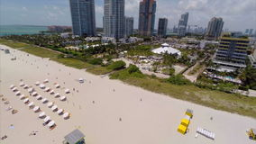 Aerial Miami Beach flyover backwards stock video footage