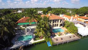 Aerial Miami mansions on the water. Aerial video of luxury mansions on Miami Beach