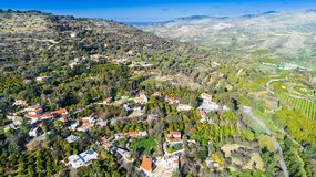 Aerial Miliou, Paphos, Cyprus. Aerial bird eye view of Miliou village hills and Akamas sea at Latchi, Paphos Cyprus. View of traditional ceramic tile roof houses Stock Image