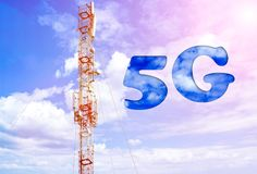 Aerial of mobile communication on a background of a blue cloudy sky. High antenna. Sun rays and glare. The inscription is 5G. The concept of mobile technology Royalty Free Stock Images