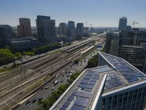 Aerial of modern sustainable office building with solar panels, part of transit oriented development at Amsterdam Zuidas. Aerial of modern sustainable office royalty free stock images