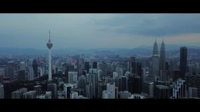 Aerial of morning view at Kuala Lumpur skyline with KLCC building and KL Tower stock footage