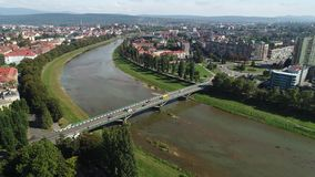 Aerial motion time lapse time-lapse of bridge and transport ower the river, uzhgorord, ukraine stock video