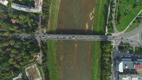 Aerial Motion Timelapse Time-Lapse of Bridge and Transport ower the River, Uzhgorord, Ukraine stock footage