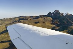 Aerial of Mount Kenya, Africa with airplane wing in foreground, the second highest mountain at 17,058 feet or 5199 Meters Stock Photos