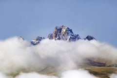 Aerial of Mount Kenya, Africa with snow and white puffy clouds in January, the second highest mountain at 17,058 feet or 5199 Mete Stock Photography